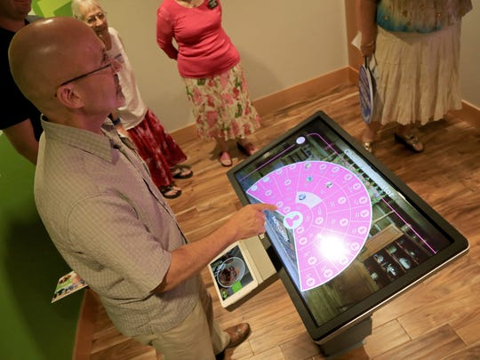 The Rev. Ralph Clingan of Good Shepherd Presbyterian Church uses interactive technology at the new St. George FamilySearch Center on Thursday to research his ancestry.