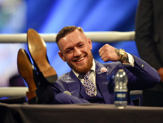 Conor McGregor reacts during a world tour press conference