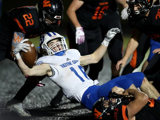 Green Bay Notre Dame's Michael Gregoire stretches over the goal line for a touchdown against West De Pere in a WIAA quarterfinal playoff game Friday at West De Pere High School.