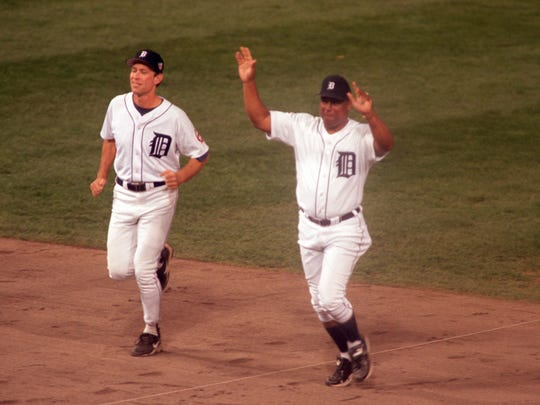 Alan Trammell (left) and Lou Whitaker(right) take the field during post-game ceremony after the Tigers and Kansas City Royals played the final game at Tiger Stadium in Detroit Monday, Sept. 27, 1999. The Tigers beat the Royals, 8-2.