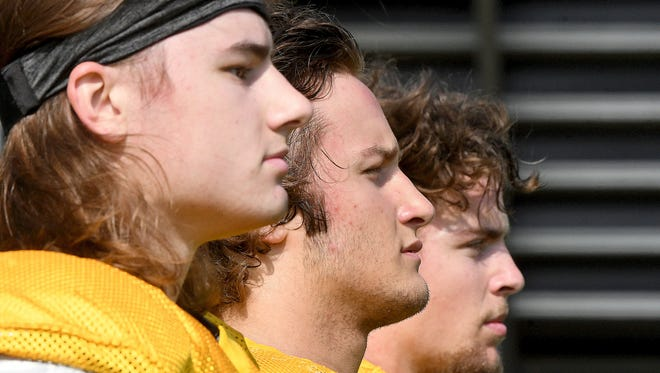 Lexington grads and South all-stars Cory Swartzmiller, TJ Gerhardt and Hunter Biddle (left to right) will room and play football together at Dension.