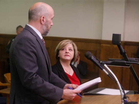 Stacey Hamilton talks with her lawyer Kevin Latta during