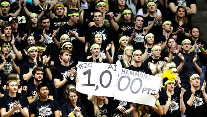 The Paint Crew celebrates as A.J. Hammons scores his 1,000th career point against Rutgers Thursday, February 26, 2015, at Mackey Arena. Purdue defeated Rutgers 92-85.