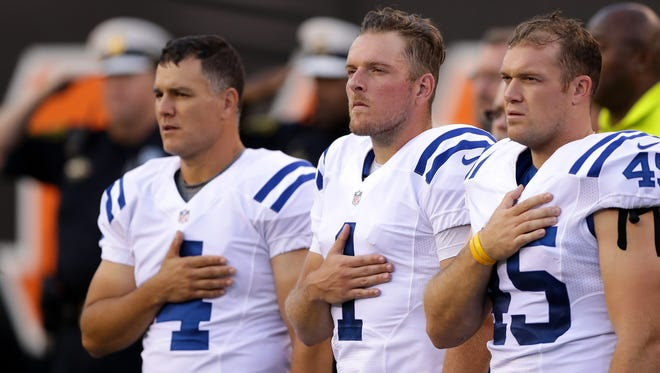 Indianapolis Colts kicker Adam Vinatieri (4), punter Pat McAfee (1) and long snapper Matt Overton (45) during the national anthem prior to the Colts facing off in their final preseason game against the Cincinnati Bengals at Paul Brown Stadium in Cincinnati on Thursday, September 1, 2016