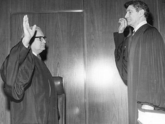 Judge Donald Mark is sworn in.