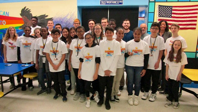 The students who took part in the advanced manufacturing session along with the program's presenters and Principal Richard Molinaro.