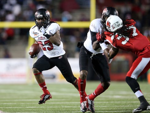 Jan 5, 2014; Mobile, AL, USA; Arkansas State Red Wolves wide receiver J.D. McKissic (23) carries the ball against the Ball State Cardinals in the first half at Ladd-Peebles Stadium. Mandatory Credit: Crystal LoGiudice-USA TODAY Sports