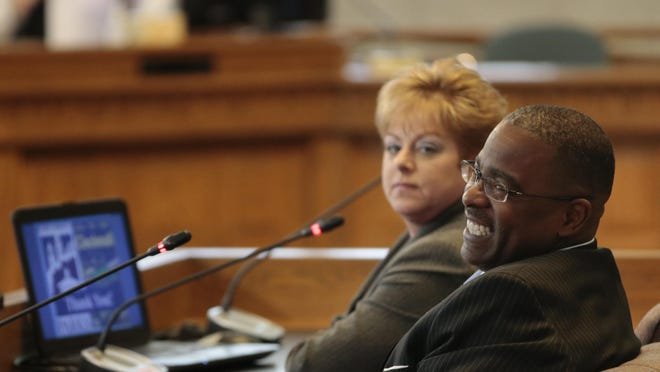 Cincinnati Park Board Director Willie Carden, right, smiles during a presentation to City Council's budget and finance committee on Monday, March 28.