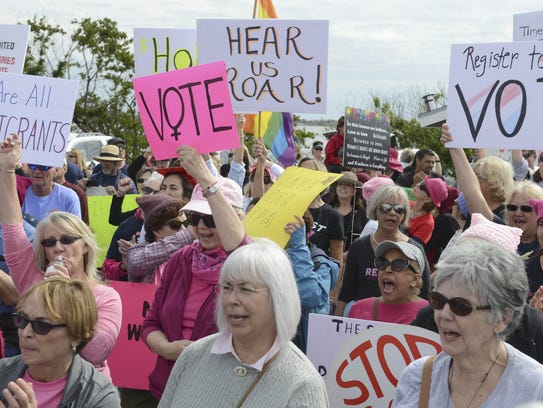 Thousands rally along the Eau Gallie Causeway during
