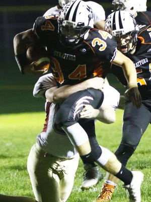 Stratford's Kade Ehrike attempts to run through a tackle in a game last fall against Rib Lake/Prentice. The junior running back/linebacker will be one of the key players for the Tigers against Stanley-Boyd Friday.