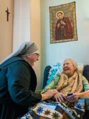 Sister Constance Veit of Little Sisters of the Poor shares a laugh with Eva Howse, a resident of a Washington, D.C., home run by the Sisters, in March.