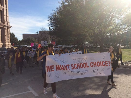 Students supporting public school vouchers demonstrated at the Texas Capitol Tuesday.