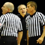 CSU basketball coach Larry Eustachy questions a call by referees in San Diego. The Mountain West and Pac-12 expanded its officiating alliance to include the WCC, WAC and Big West.