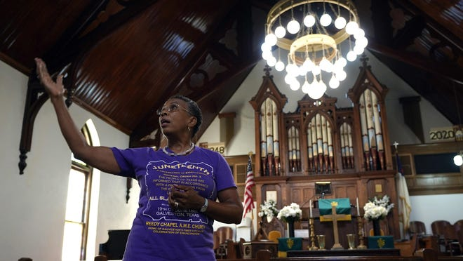 Sharon Gillins talks about the history of the Reedy Chapel African Methodist Episcopal Church, Wednesday, in Galveston. The church's origins date back to 1848 when black slaves were given the land by their white owners for a place of worship. It also continues to host a Juneteenth celebration that is attended by the community.