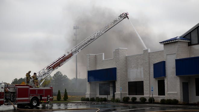 Emergency personnel battle a three-alarm fire at the chemical company ResinTech Inc., Thursday, May 8, 2014 in West Berlin.