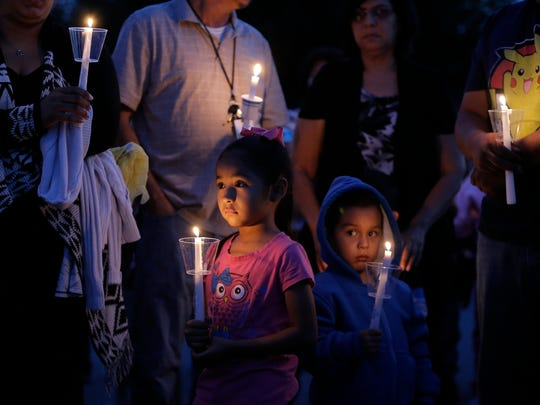A candlelight vigil was held Tuesday for Kaiden Cervantes, 2, Jaden Vela, 7, and Nyine Vela, 5, who died in a fire in their grandfather's trailer in Socorro.
