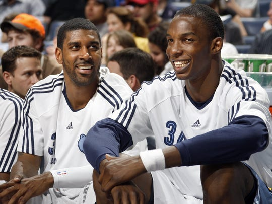 The Grizzlies' O.J. Mayo and Hasheem Thabeet get a rest against the Rockets in a game in 2010.