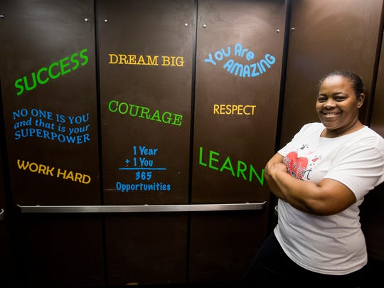 Earnestine Woods is shown in a repainted elevator at Brewbaker Middle School, where her organization Have a Heart 4 Children worked on a spring break project on March 9, 2018.