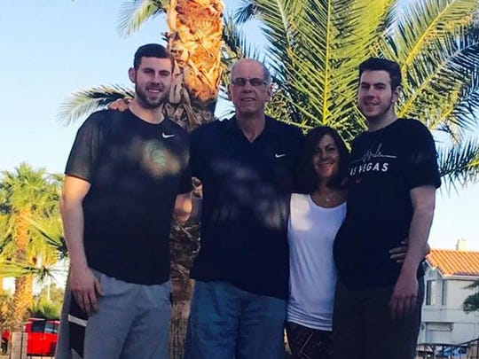 Michigan State senior basketball player Ben Carter poses with family members (from left) father Mike Carter, mother Hadar Carter and brother Tim Carter.