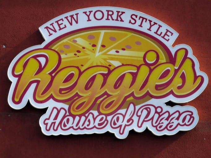 Former football standout Reggie Slack has opened a new restaurant, Reggie's House of Pizza just east of the Holley By The Sea subdivision on highway 98.