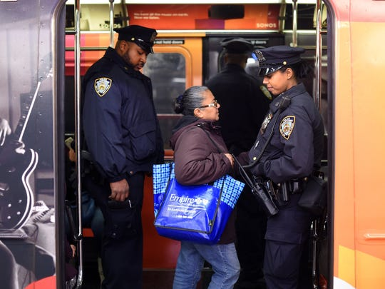 New York Police Department officers patrol the subway at Times Square in  New York  Nov. 14, 2015,  the morning after the attacks that killed at least 128 people in Paris. Police are increasing their presence after the March 22, 2016, explosions in Brussels