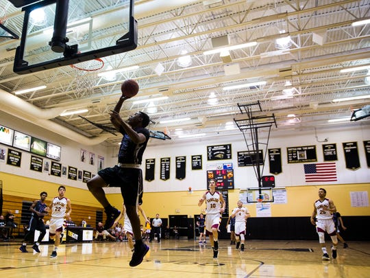 Timber Creek High School sophomore, Peter Hayes, drives down the court to shoot a layup during the championship game of the Holiday Hoopfest against Loyola Academy on Friday, December 30, 2016 at Golden Gate High School in Golden Gate. Loyola Academy won over Timber Creek High School, 59 to 50.