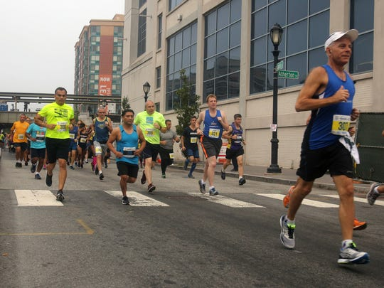 Runners take off from Larkin Plaza in Yonkers at the