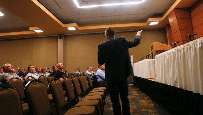 James Glover, a consultant with Once a Day Marketing, leads an Outdoor Recreation Industry Initiative meeting Thursday at the Farmington Civic Center.