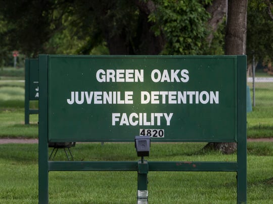 The sign in front of the Green Oaks Juvenile Detention Facility where the facility is over-budget and searching for a new director.