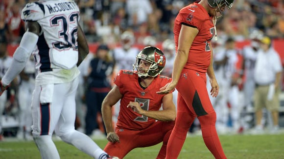 Tampa Bay Buccaneers kicker Nick Folk (2) reacts after missing a field goal against the New England Patriots during the fourth quarter of an NFL football game against the New England Patriots Thursday, Oct. 5, 2017, in Tampa, Fla. Holding for the Buccaneers is Bryan Anger. (AP Photo/Phelan Ebenhack)
