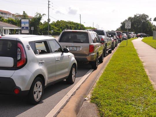 Cars line up for gas at BJ's on Merritt Island. Brevard