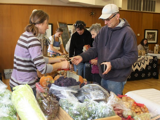 Danielle Boerson of Boerson Farms sells her organically grown produce and pasture-raised meats at Town Square's fall market.