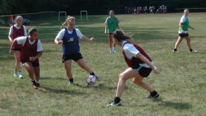Members of Albertus Magnus' girls soccer team practice during a pre-season session at Albertus Magnus High School on August 25, 2015.