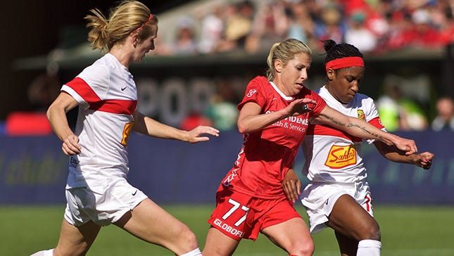 Portland Thorns midfielder McCall Zerboni (77), the ex-Flash star, fights for the ball with WNY midfielder Sam Mewis, left, and forward Jasmyne Spencer.