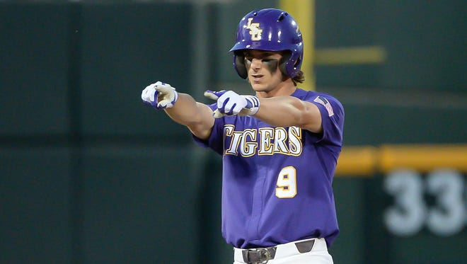 LSU Tigers outfielder Zach Watson (9) points to the dugout after driving in a run with a double in the ninth inning against the Florida State Seminoles at TD Ameritrade Park Omaha.