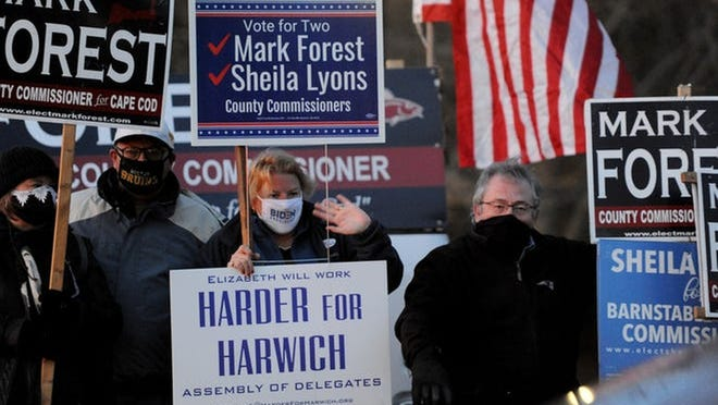 Mark Forest, candidate for Barnstable County Commissioner, right, was joined by Harwich residents Deb and Dana DeCosta, and Elizabeth Harder, second from right, outside the Harwich Community Center Tuesday evening. Harder is running for a set on the Barnstable Assembly of Delegates.