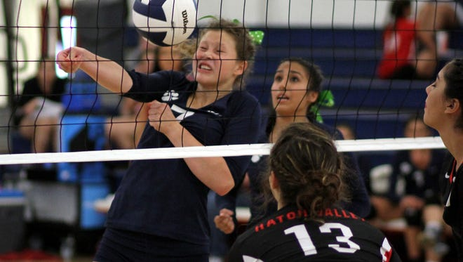 Junior middle hitter Elena Williams (7) battles Hatch hitters at the net while teammate Micah Trevizo looks on from behind. The Hatch Valley High Bears took a three-game sweep Tuesday at Deming High School, 25-20, 25-17 and 25-17.