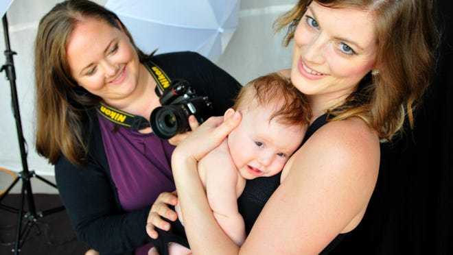Natalie McCain of Natalie McCain Photography is working on The Honest Body Project, photographing women with children to help women love themselves and instill a healthy body image in their daughters. She was photographing Crystalyn Koch and her 5-mont- old daughter Violet in her studio.