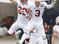 Stanford defensive back Dallas Lloyd, left, and teammate