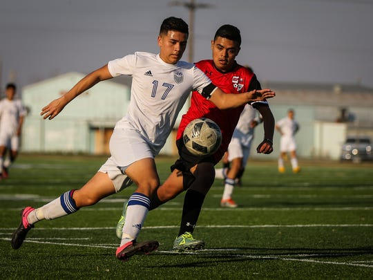 Lake View's Brian Salas battles for possession of the ball in a District 4-5A game against Lubbock Coronado on March 7, 2017.
