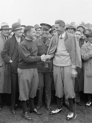 In this March 25, 1934 file photo Horton Smith, right, is congratulated by golf legend and Masters co-founder Bobby Jones after winning the first Masters golf tournament in Augusta, Ga.