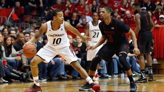 Bearcats guard Troy Caupain controls the ball against Temple guard Jesse Morgan at Fifth Third Arena on Jan. 17.