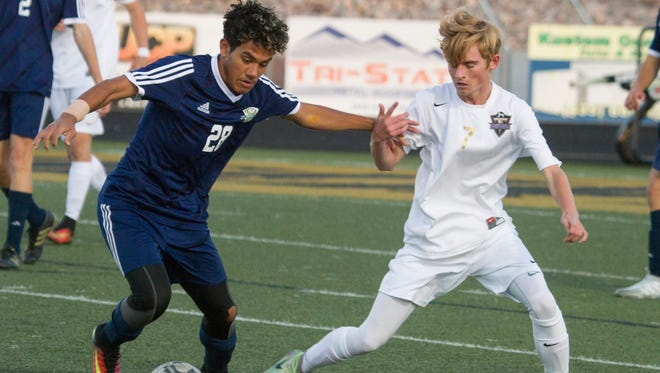 Snow Canyon's Richard Vichi (left) shown in an earlier game this season against Desert Hills.