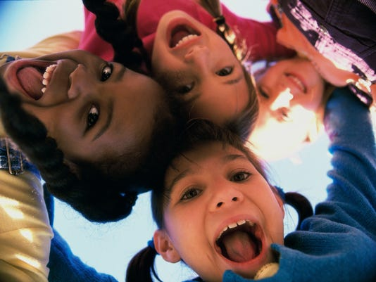portrait of children looking down into the camera