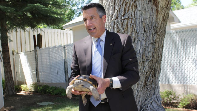 """Gov. Brian Sandoval adopted a desert tortoise named """"Carson"""" on Thursday. Carson will live in the Governor's Mansion and could live to be 100 years old."""