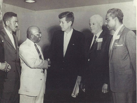 Dr. Mitchell Spellman (far right) stands with a group including then-Sen. John F. Kennedy around 1960. Family members believe the future president was meeting with either black members of the National Medical Association or alumni of Howard Medical School.