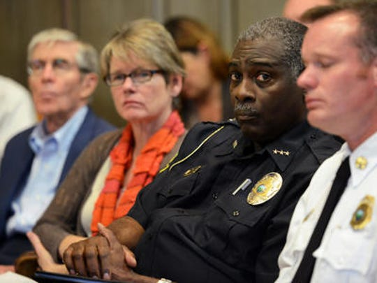 Police Chief William Anderson looks on as City Manager Gary Jackson addresses the Asheville City Council on the leadership and routines of the Asheville Police Department on Oct. 28.