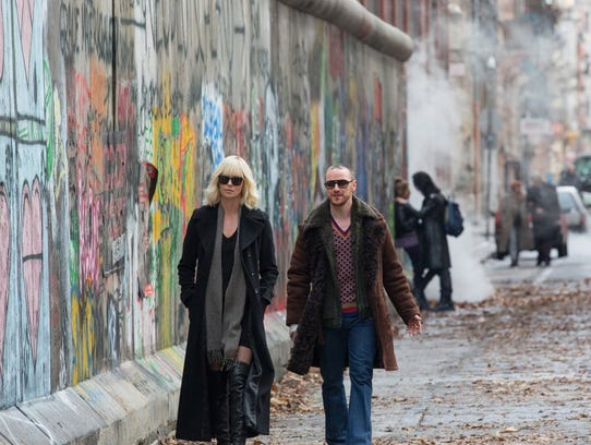 """-Charlize Theron and James McAvoy in """"Atomic Blonde."""""""