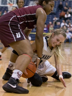 Manasquan's Stella Clark and University's Teylahna Green battle for a loose ball. 2016 NJSIAA Girls Basketball Tournament of Champions quarterfinal matchup featuring University vs Manasquan.Toms River, NJ Wednesday, March 16, 2016@DhoodHood