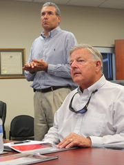 City Administrator Rick Cotton, left, and CATbus CEO Al Babinicz, right, listen to consultant Dan Boyle speak during a meeting Wednesday at Clemson City Hall to discuss the future of CATbus.